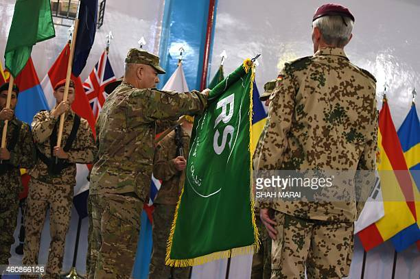 General John Campbell opens the flag of Resolute Support during a ceremony marking the end of ISAF's combat mission in Afghanistan at ISAF...