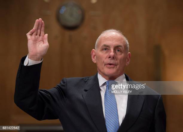 General John Kelly USMC is sworn in to testify at the Senate Homeland Security and Governmental Affairs Committee hearing on his nomination to be...