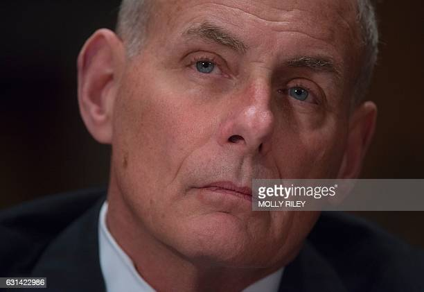 General John Kelly USMC listens to questioning while testifying at the Senate Homeland Security and Governmental Affairs Committee hearing on his...