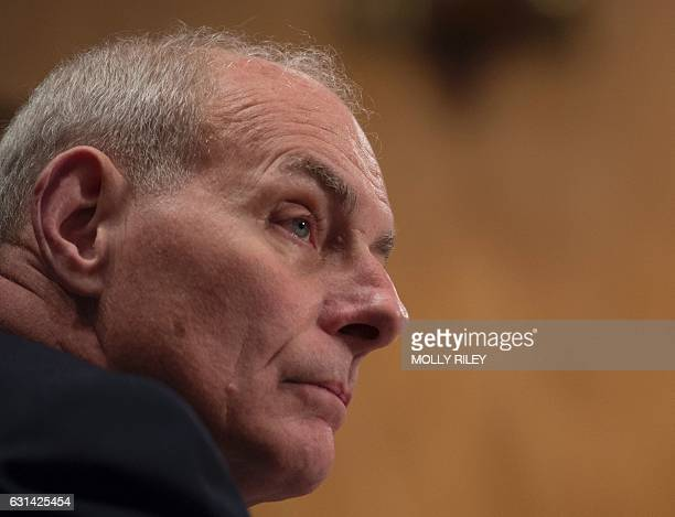 General John Kelly USMC listens to questions as he testifies at the Senate Homeland Security and Governmental Affairs Committee hearing on his...