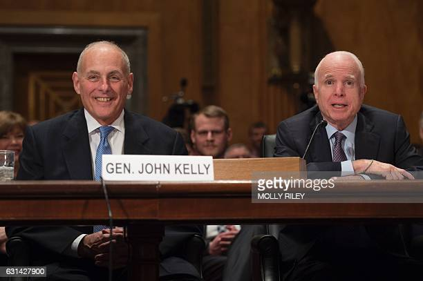 General John Kelly USMC listens while Senator John McCain gives a statement endorsing him at the Senate Homeland Security and Governmental Affairs...