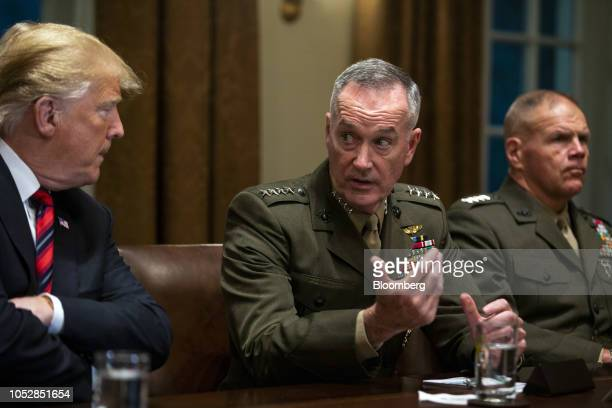 General Joseph Dunford chairman of the Joint Chiefs of Staff center speaks as US President Donald Trump left listens during a briefing with senior...