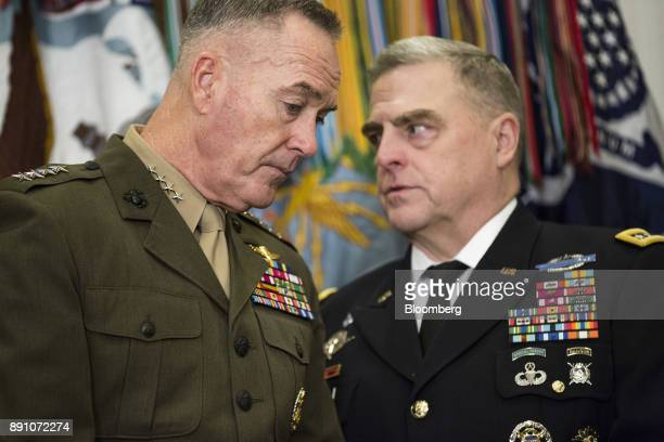 General Joseph Dunford chairman of the Joint Chiefs of Staff left talks to General Mark Milley chief of staff with the US Army before US President...