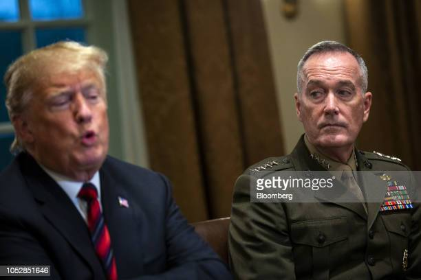 General Joseph Dunford chairman of the Joint Chiefs of Staff right listens as US President Donald Trump speaks during a briefing with senior military...