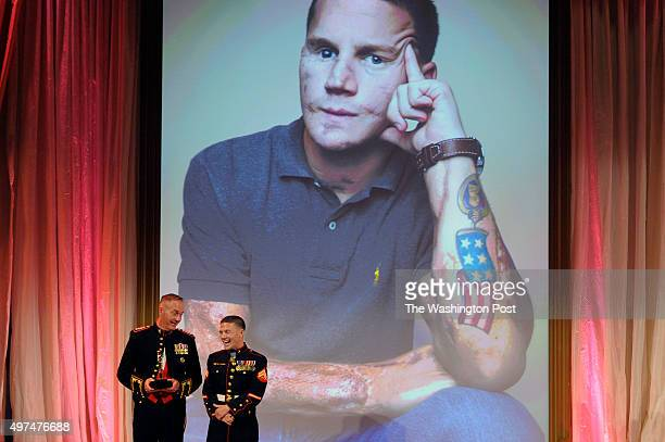 General Joseph Dunford presents the the first American Portrait Prize to Corporal Kyle Carpenter at the National Portrait Gallery November 15 2015 in...