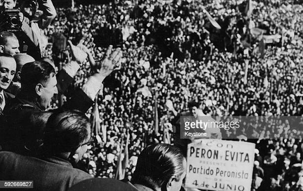 General Juan Peron Dictator of Argentina raising his arms as he speaks to a huge crowd in Argentina circa 1955