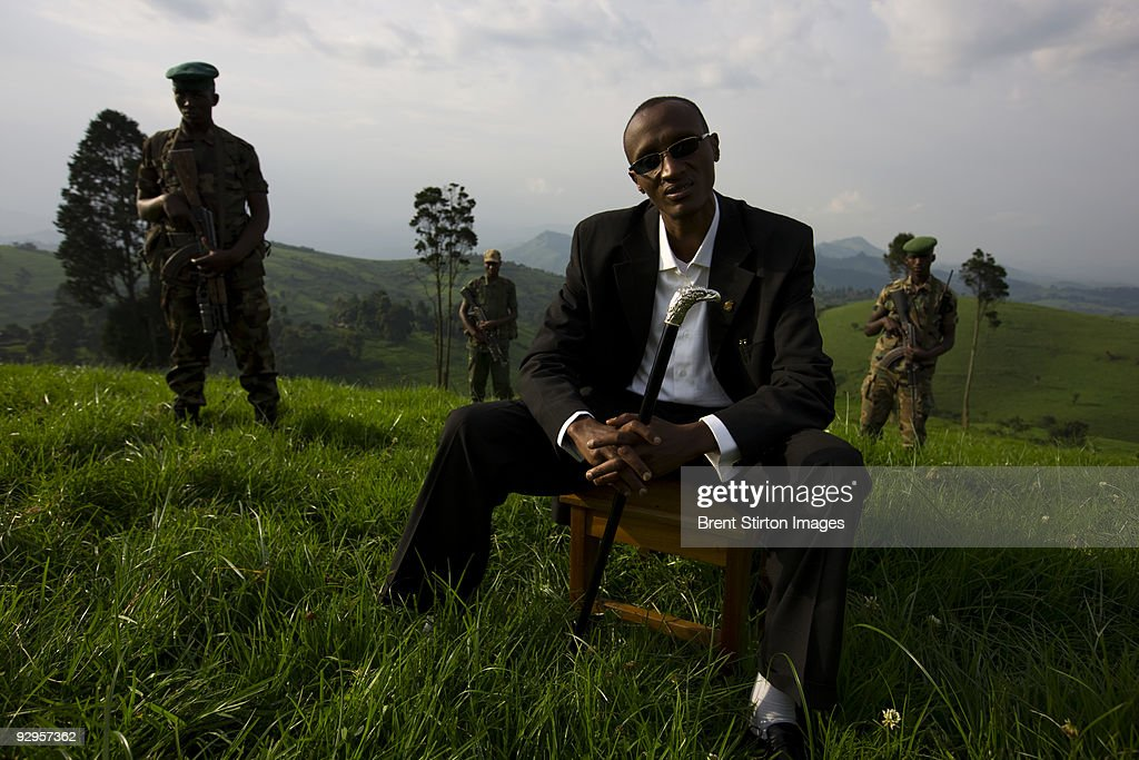General Laurent Nkunda interviewed by National Geographic Magazine at one of his headquarters in Kiroliwre, Masisi. Nkunda states that he is all for conservation and says that he believes that Virunga National Park is an important resource for the Congolese people which must be preserved. He invited the return of ICCN with full transparency and a promise of support from his men who are currently occupying the Mikeno sector, the gorilla sector of Virunga. At the same time as these photos were being taken, ICCN were attempting to negotiate with Nkunda's men in the Mikeno section for re-entry by ICCN. They were told by Nkunda's men, under Nkunda's second in command, in emphatic threatening terms, that if they had not been accompanied by UN peacekeepers they would have been killed. It was also discovered that the road into Bukima, a key gorilla area, has purportedly been mined. These facts directly contradict what General Nkunda told us at the time of this shoot. We have asked for clarification from Nkunda at this time.