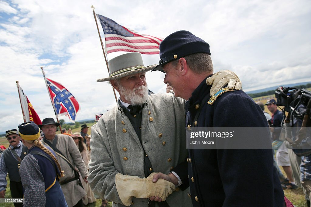 'General Lee' greets a Union soldier following a re-enactment of Pickett's Charge on the 150th anniversary of the historic Battle of Gettysburg on July 3, 2013 in Gettysburg, Pennsylvania . The charge, which occurred on July 3, 1863 - the last day of the three-day battle, was a decisive Confederate defeat and widely considered the turning point in the American Civil War in favor of the Union. Federal and Confederate armies suffered a combined total of 51,000 casualties over three days, the highest number of any battle in the four-year war.