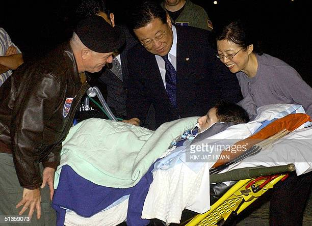 General Leon J LaPorte commander of the United States Forces in Korea greets Shin HyeongJin an ailing South Korean college student who arrives on a...