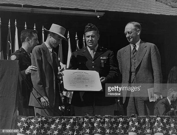 General Leslie Groves presents the ArmyNavy 'E' Production Award to the University of California's lab at Los Alamos for the production of the atomic...