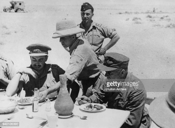 General Ludwig Crüwell of the German Afrika Korps is given a meal in the officers' mess of a British camp in Libya after his capture World War II...