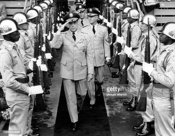 US General Lyman L Lemnitzer commanderinchief of the NATO forces in Europe passing honor guards at the beginning of the celebration of the 20th...