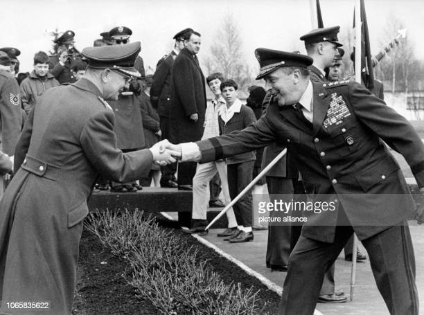 US General Lyman L Lemnitzer welcoming the Inspector General of the Bundeswehr General Ulrich de Maiziere during a military parade in honor of the...