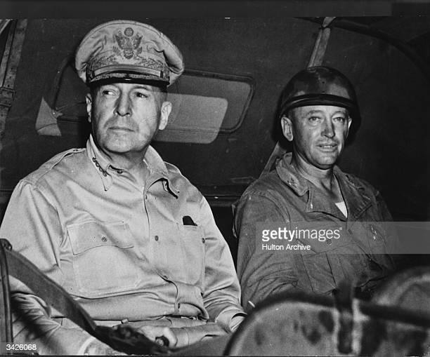 General MacArthur and an aide in a jeep on an inspection tour of an American encampment in the Southwest Pacific