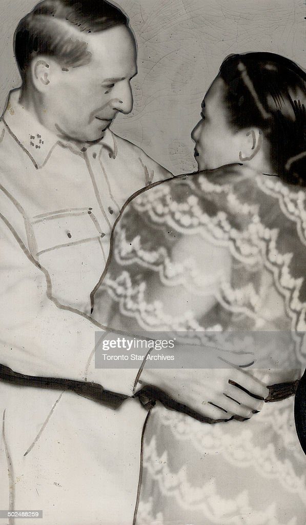 General MacArthur; back in Manila as he promised; greets the wife of the newly installed Philippines : News Photo