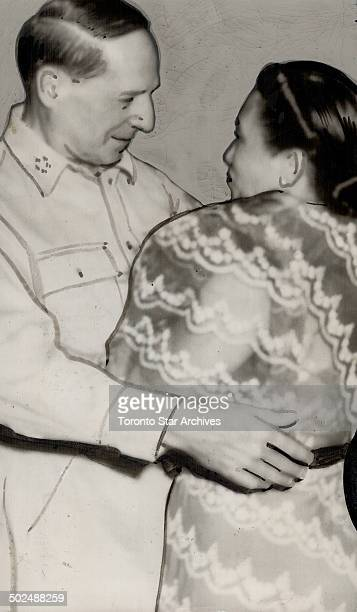 General MacArthur back in Manila as he promised greets the wife of the newly installed Philippines President Osmena