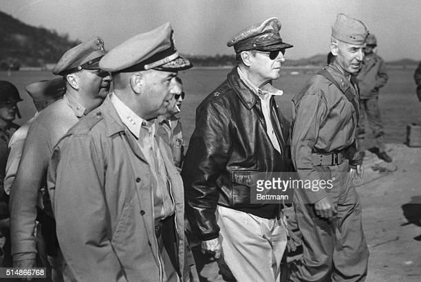 General MacArthur begins his inspection tour of the facilities in the Inchon area From left to right Vice Admiral Arthur D Struble General Douglas...