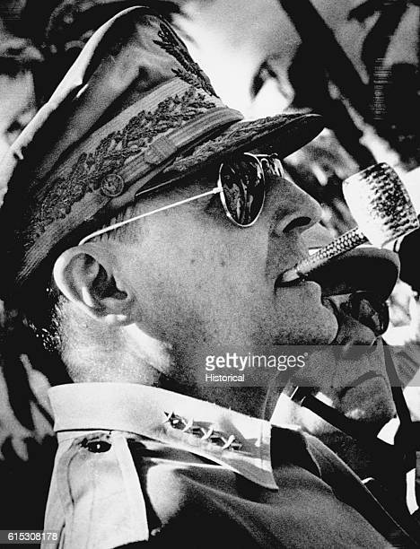 General MacArthur surveys the beachhead on Leyte Island soon after American forces swept ashore from a gigantic liberation armada into the central...