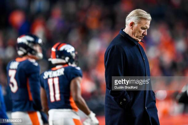 General manager and President of Football Operations of the Denver Broncos John Elway stands on the sideline in the fourth quarter of a game between...