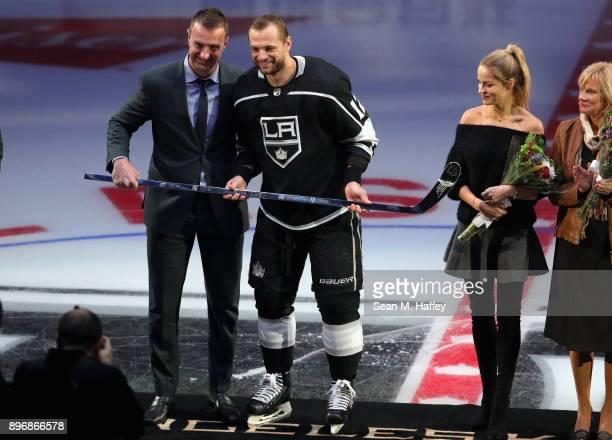 General Manager and Vice President Rob Blake presents Marian Gaborik of the Los Angeles Kings with a silver stick in honor of his one thousand games...