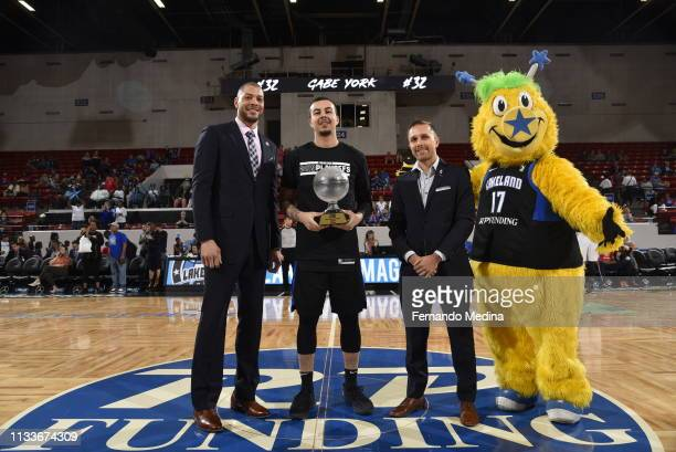 General Manager Anthony Parker and G-League representative David Wagner present Gabe York of the Lakeland Magic with the Jim Collier Sportsmanship...