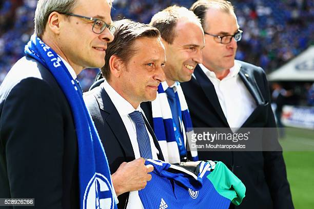 General manager at Schalke 04 Horst Heldt is presented a shirt after he speaks to the fans during the Bundesliga match between FC Schalke 04 and FC...