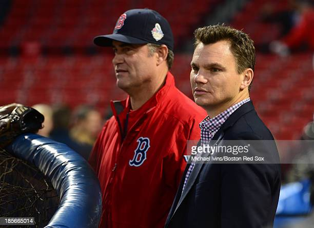 General Manager Ben Cherington of the Boston Red Sox watches batting practice with Manager John Farrell before the start of Game One of the World...