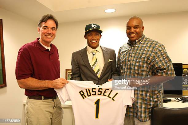 General Manager Billy Beane and scout Kelcey Mucker of the Oakland Athletics stands with first round draft pick Addison Russell at the OaklandAlameda...
