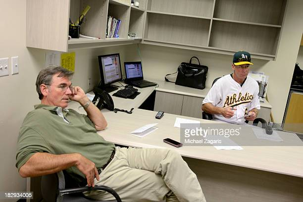 General Manager Billy Beane of the Oakland Athletics relaxes with Manager Bob Melvin in the clubhouse prior to the game against the Los Angeles...