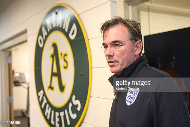 General Manager Billy Beane of the Oakland Athletics stands in the clubhouse during a spring training workout at Papago Park on February 29 2012 in...