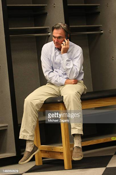 General Manager Billy Beane of the Oakland Athletics talks on the phone in the war room during the first day of the MLB Draft at the OaklandAlameda...