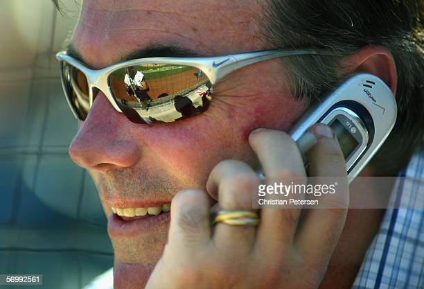 General manager Billy Beane of the Oakland Athletics talks on the phone during the MLB Spring Training game against the Milwaukee Brewers at Phoenix...
