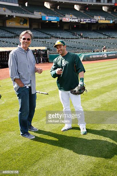 General Manager Billy Beane of the Oakland Athletics talks with Nick Punto on the field prior to the game against the Los Angeles Angels of Anaheim...