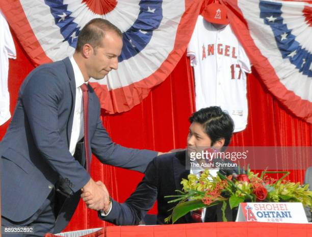 General Manager Billy Eppler and Shohei Ohtani of Los Angeles Angels of Anaheim shake hands during a press conference at Angel Stadium of Anaheim on...