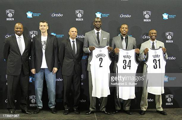 General Manager Billy King majority owner Mikhail Prokhorov Head Coach Jason Kidd Kevin Garnett Paul Pierce and Jason Terry of the Brooklyn Nets pose...