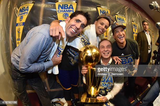 General Manager Bob Meyers Stephen Curry and coowners Joe Lacob and Peter Guber pose for a portrait with the Larry O'Brien Championship Trophy after...