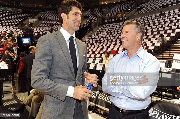 General manager Bob Myers of the Golden State Warriors and general manager Neil Olshey of the Portland Trail Blazers talk before Game Three of the...