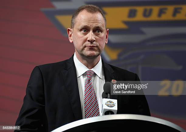 General Manager Brad Treliving of the Calgary Flames speaks at the podium during round one of the 2016 NHL Draft at First Niagara Center on June 24...
