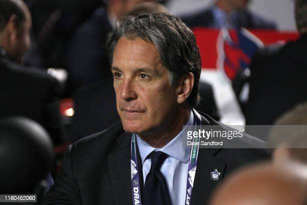 General manager Brendan Shanahan of the Toronto Maple Leafs look on from the team draft table during the first round of the 2019 NHL Draft at Rogers...