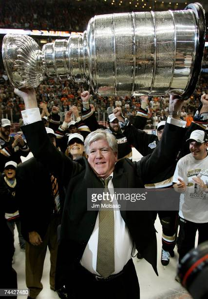 General Manager, Brian Burke of the Anaheim Ducks hoists the Stanley Cup after his team's victory over the Ottawa Senators 6-2 during Game Five of...