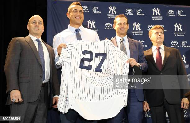 General Manager Brian Cashman Giancarlo Stanton Manager Aaron Boone and owner Hal Steinbrenner of the New York Yankees pose for a photo after Stanton...