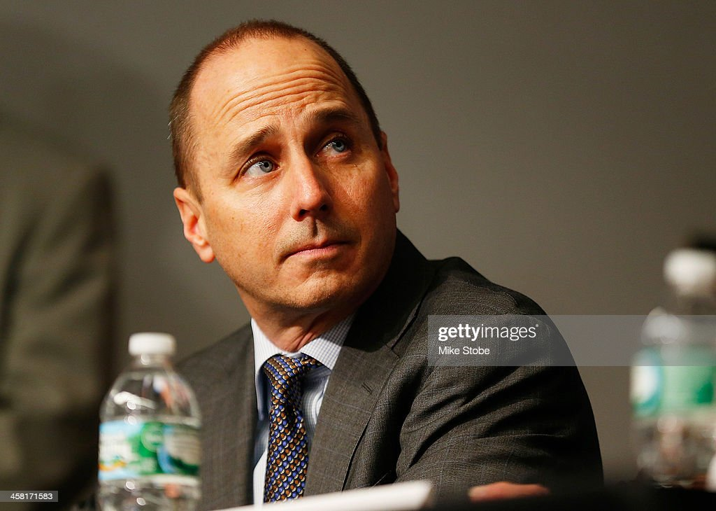 General Manager Brian Cashman looks on during Carlos Beltran's introductory press conference at Yankee Stadium on December 20, 2013 in the Bronx borough of New York City.