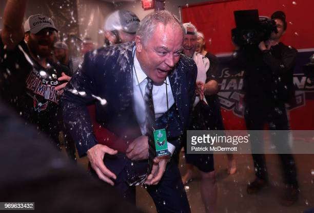 General manager Brian MacLellan of the Washington Capitals celebrates in the locker room after his team defeated the Vegas Golden Knights 43 in Game...