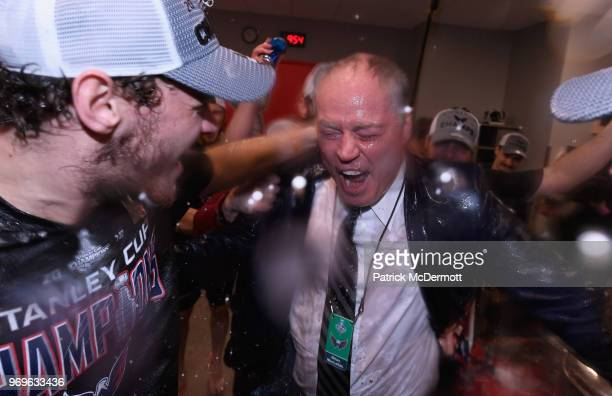 General manager Brian MacLellan of the Washington Capitals drinks from the Stanley Cup in the locker room after his team defeated the Vegas Golden...