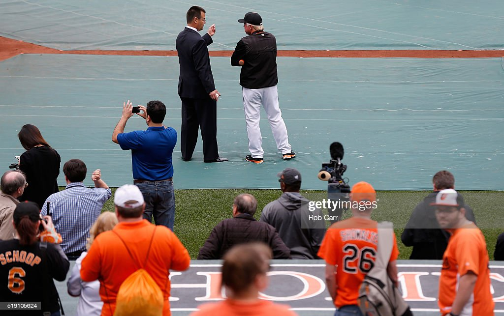 General manager Dan Duquette (L) and Buck Showalter #26 of the Baltimore Orioles talk before the start of their Opening Day game against the Minnesota Twins Oriole Park at Camden Yards on April 4, 2016 in Baltimore, Maryland.