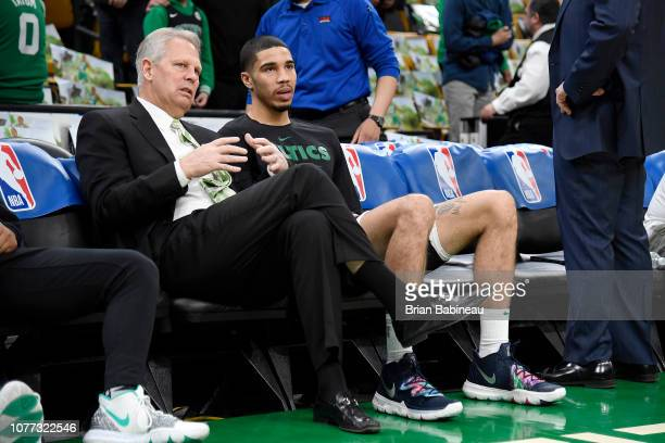 General Manager Danny Ainge and Jayson Tatum of the Boston Celtics talk before the game against the Dallas Mavericks on January 4, 2019 at the TD...
