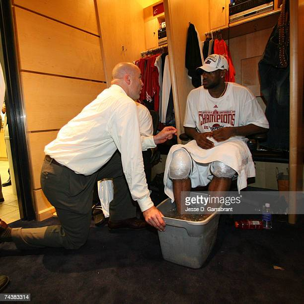 General Manager Danny Ferry of the Cleveland Cavaliers speaks to LeBron James after defeating the Detroit Pistons in Game Six of the Eastern...