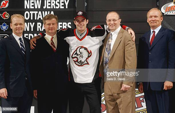 General manager Darcy Regier, Jim Benning, #13 overall draft pick Drew Stafford, Don Luce and head coach Lindy Ruff of the Buffalo Sabres pose during...