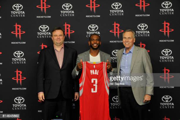 General Manager Daryl Morey of the Houston Rockets Chris Paul and Head Coach Mike D'Antoni poses for a photo during a press conference on July 14...