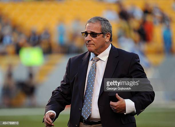 General Manager Dave Gettleman of the Carolina Panthers looks on from the field before a preseason game against the Pittsburgh Steelers at Heinz...